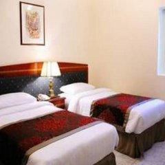 Отель Al Sharq Furnished Suites ОАЭ, Шарджа - отзывы, цены и фото номеров - забронировать отель Al Sharq Furnished Suites онлайн комната для гостей фото 2