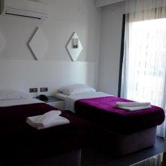 Mert Hotel Номер Делюкс с 2 отдельными кроватями фото 3