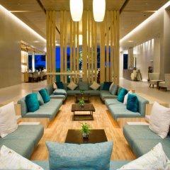 Отель Holiday Inn Resort Phuket Mai Khao Beach пляж Май Кхао интерьер отеля фото 3