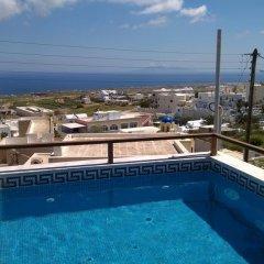 Отель Anemomilos Suites Греция, Остров Санторини - отзывы, цены и фото номеров - забронировать отель Anemomilos Suites онлайн бассейн фото 3