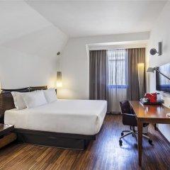 Отель NH Milano Touring 4* Улучшенный номер разные типы кроватей фото 14