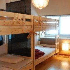 Отель Tabicolle Backpackers Кровать в общем номере фото 15