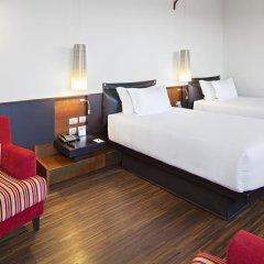 Отель NH Milano Touring 4* Стандартный номер двуспальная кровать фото 4