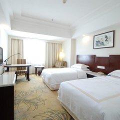 Overseas Chinese Friendship Hotel 3* Номер Делюкс с 2 отдельными кроватями фото 3