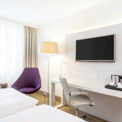 Отель NH Collection Berlin Mitte Am Checkpoint Charlie 4* Улучшенный номер с разными типами кроватей фото 3