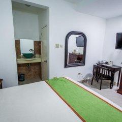 Отель Altamont West Hotel Ямайка, Монтего-Бей - отзывы, цены и фото номеров - забронировать отель Altamont West Hotel онлайн комната для гостей фото 2
