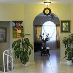 Отель Retreat Guest House Ямайка, Дискавери-Бей - отзывы, цены и фото номеров - забронировать отель Retreat Guest House онлайн интерьер отеля фото 3