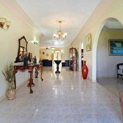 Отель Valencia Villa Ямайка, Очо-Риос - отзывы, цены и фото номеров - забронировать отель Valencia Villa онлайн интерьер отеля