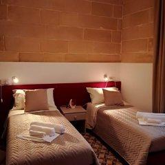 Отель Concetta Host House Мальта, Гранд-Харбор - отзывы, цены и фото номеров - забронировать отель Concetta Host House онлайн комната для гостей фото 5