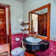 Отель Nhi Nhi 3* Номер Делюкс фото 11