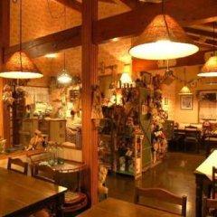 Отель Pension Flying Jeep Япония, Минамиогуни - отзывы, цены и фото номеров - забронировать отель Pension Flying Jeep онлайн гостиничный бар