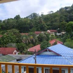 Отель Patong Bay Guesthouse балкон