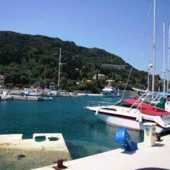 Отель Skevoulis Studios Греция, Корфу - отзывы, цены и фото номеров - забронировать отель Skevoulis Studios онлайн приотельная территория фото 2