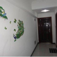 Отель Xi'an Haojia Apartment Китай, Сиань - отзывы, цены и фото номеров - забронировать отель Xi'an Haojia Apartment онлайн интерьер отеля