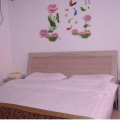 Отель Xi'an Haojia Apartment Китай, Сиань - отзывы, цены и фото номеров - забронировать отель Xi'an Haojia Apartment онлайн комната для гостей фото 4