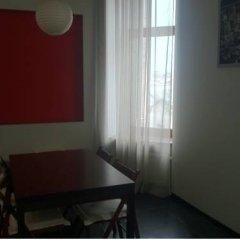 Апартаменты Учитель комната для гостей фото 2