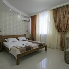 Апартаменты Лотос комната для гостей фото 3