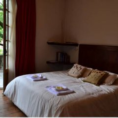 Отель El Capricho del Tigre Bed & Breakfast Тигре комната для гостей фото 5