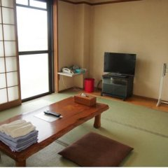Отель Minshuku Takesugi Якусима комната для гостей фото 5