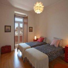 Отель Traveling To Lisbon Graca Apartments Португалия, Лиссабон - отзывы, цены и фото номеров - забронировать отель Traveling To Lisbon Graca Apartments онлайн комната для гостей фото 3