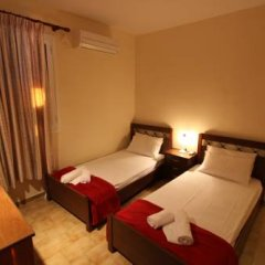 Отель Corfu Glyfada Menigos Resort сейф в номере