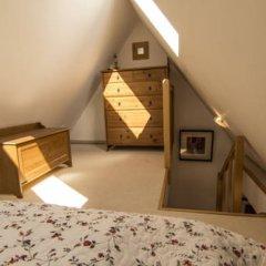 Отель Apartamenty Snowbird Zakopane Косцелиско сейф в номере