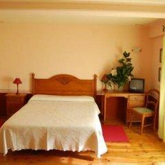 Отель La Casa del Jardin комната для гостей