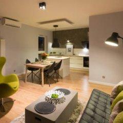 Апартаменты Friendly Inn Apartments комната для гостей фото 3