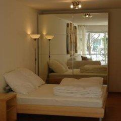Апартаменты Nanuk Apartment 2 Мюнхен комната для гостей фото 2
