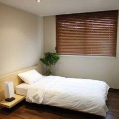 An Guesthouse For Female Only (гостевой дом для женщин) комната для гостей фото 4
