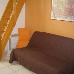 Апартаменты Studio Longchamp комната для гостей