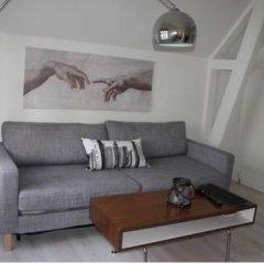 Апартаменты Bergen Apartments Берген комната для гостей фото 3