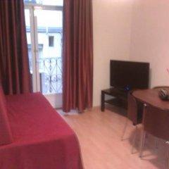 Апартаменты Km1 Atocha Apartments комната для гостей фото 2