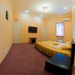 Апартаменты Four Season Apartments комната для гостей