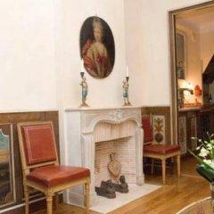 Отель Studios Paris Appartement Louis XIV Франция, Париж - отзывы, цены и фото номеров - забронировать отель Studios Paris Appartement Louis XIV онлайн интерьер отеля