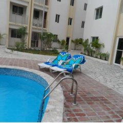 Отель Apartamento Aquarel Доминикана, Бока Чика - отзывы, цены и фото номеров - забронировать отель Apartamento Aquarel онлайн бассейн фото 2