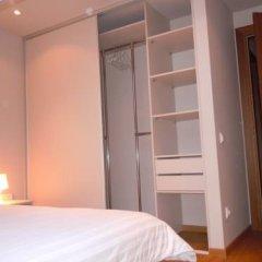 Апартаменты Milo Apartment сейф в номере