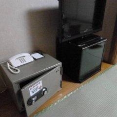 Отель Aso Ikoi no Mura Минамиогуни сейф в номере