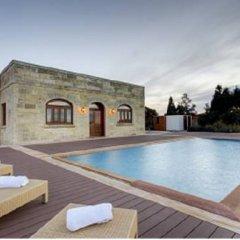 Отель Villa Munqar бассейн