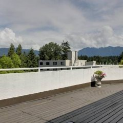 Отель Rosellen Suites At Stanley Park Канада, Ванкувер - отзывы, цены и фото номеров - забронировать отель Rosellen Suites At Stanley Park онлайн балкон