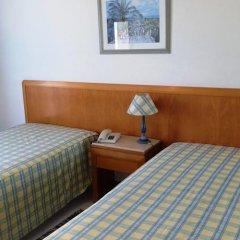 Отель Apartamentos Turisticos Algarve Mor Португалия, Портимао - отзывы, цены и фото номеров - забронировать отель Apartamentos Turisticos Algarve Mor онлайн комната для гостей фото 4