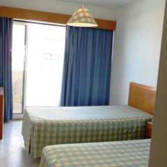 Отель Apartamentos Turisticos Algarve Mor Португалия, Портимао - отзывы, цены и фото номеров - забронировать отель Apartamentos Turisticos Algarve Mor онлайн комната для гостей фото 3