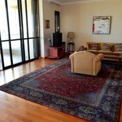 Апартаменты Ziv Apartments - Brasil 1 Тель-Авив комната для гостей фото 5