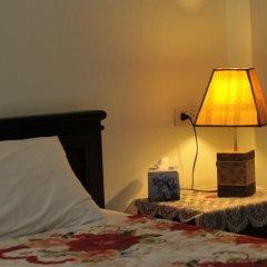 Отель Thira House в номере