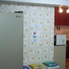 Отель MiNi Residence сейф в номере