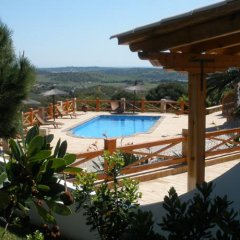Отель Monte da Bravura Green Resort бассейн