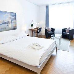 Апартаменты Jenatsch Apartments комната для гостей фото 4