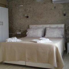 Отель Köşem Konukevi Чешме комната для гостей фото 5