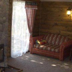 Гостевой Дом Деревенька комната для гостей фото 4
