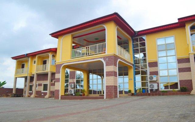 Отель Esre Blues Hotel Нигерия, Калабар - отзывы, цены и фото номеров - забронировать отель Esre Blues Hotel онлайн вид на фасад